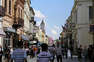 Mixed-use development - Traditional mixed-use development: residential and retail, pedestrian-friendly street in Bitola, Macedonia