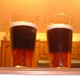 Half and half - Black and Tan drinks prepared with a blend of Guinness stout and Bass pale ale