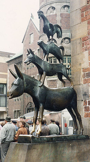Town Musicians of Bremen - A bronze statue by Gerhard Marcks depicting the Bremen Town Musicians located in Bremen, Germany. The statue was erected in 1953. Note the front hooves that have become shiny. Touching the front hooves is said to make wishes come true.