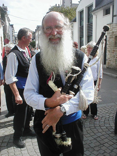Breton pipe player