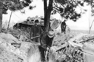 Reich Labour Service - RAD members digging a trench for a RAD flak battery in March 1945