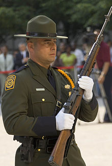 566e279f81ded U.S. Customs and Border Protection Agent in ceremonial dress wearing a  campaign hat
