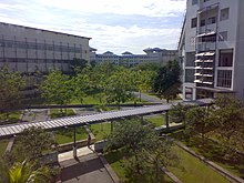 An aerial view of Multimedia University's Cyberjaya campus' garden and covered walkway.
