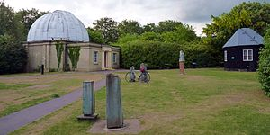 Institute of Astronomy, Cambridge - Observatory buildings containing the Northumberland Telescope (left) and Thorrowgood Telescope (right) at the Institute of Astronomy of the University of Cambridge. Covered structures in the foreground are mounts for portable telescopes.