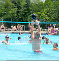 Campers and counselors at Kids AT enjoy a game of volleyball in the swimming pool during a break from activities at Camp Atterbury Joint Maneuver Training Center on Camp Atterbury, Ind., July 12, 2011 110712-A-AM585-367.jpg