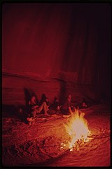 Camping at Night During a Week - Long Hiking Trip through Water Canyon and the Maze, a Remote and Rugged Region in the Heart of the Canyonlands, 05-1972 (3814166487).jpg