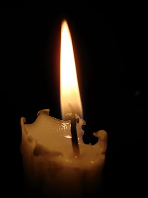 A picture of Candle burning at dark room. Snap...
