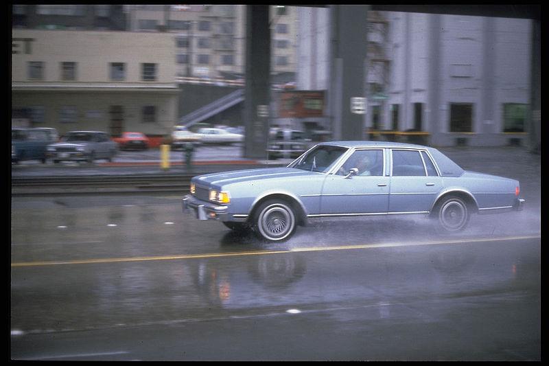 File:Car in rain, Seattle, 1980s.jpg