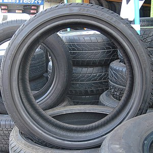 Stacked and standing car tires