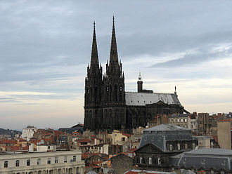 Clermont-Ferrand Cathedral - View from the south. The black Gothic cathedral towers above the city with its dominating spires 96.1 metres high.