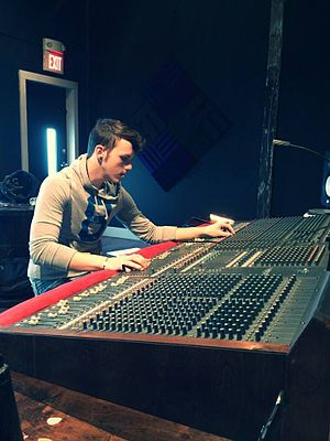 Mixing engineer - Mixing engineer working with a 40-channel analog mixing console