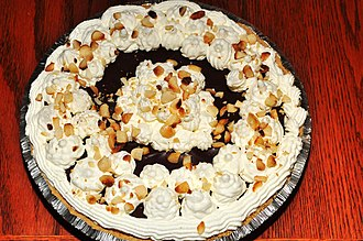 Graham cracker crust - A chocolate cream pie with a graham cracker crust and macadamia nuts