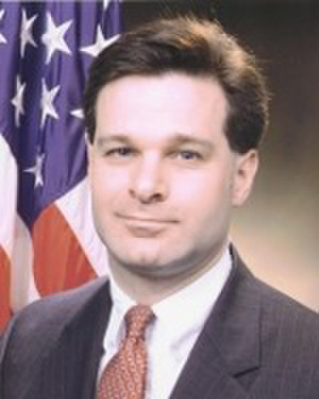 From commons.wikimedia.org: Christopher A Wray DOJ portrait {MID-148299}