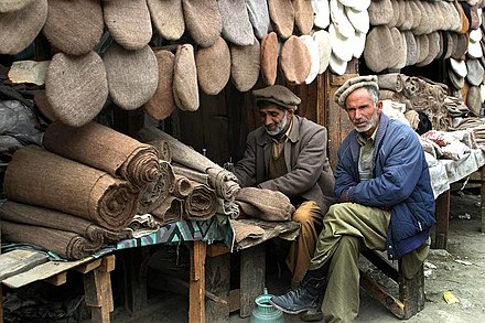 Pakistani street vendors operating a Pakol shop in Gilgit-Baltistan  the cap  is slightly 33b018450ac