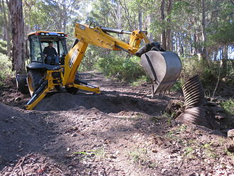 Department of Parks and Wildlife (Western Australia) - Western Australia Parks and Wildlife Conservation Employee changing a culvert pipe at Dombakup Block, Warren State Forest in May 2015.