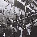 "DISEMBARKATION OF NEW IMMIGRANTS FROM THE PORTUGUESE SHIP ""NYASSA"" AT THE HAIFA PORT. עולים חדשים מגיעים לנמל חיפה באונייה פורטוגזית.D820-042.jpg"