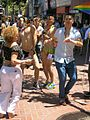 Dancing on the sidewalk (14534654241).jpg