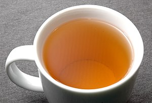 Phenolic content in tea - Darjeeling black tea infusion: Finer black tea has a more orange tone than red as a result of higher theaflavins content.