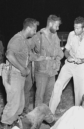 Ariel Sharon - Sharon (left), armed with Ka-Bar combat knife, stands with other paratroop commandos, before Operation Olive Leaves, 1955.