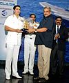 Defence Minister Manohar Parrikar being felicitated by Admiral RK Dhowan.jpg