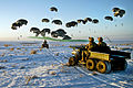 Defense.gov News Photo 110130-A-0000X-540 - U.S. Army soldiers in four-wheel drive vehicles wait as bundles of fuel are air delivered by a C-17 Globemaster III to Forward Operating Base Waza.jpg