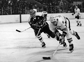 Washington Capitals - Capitals left winger Errol Rausse chasing Boston Bruins defenseman Ray Bourque in 1979.