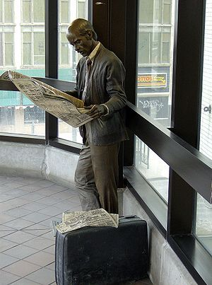Grand Circus Park station - Catching Up by J. Seward Johnson, Jr. at Grand Circus Park station