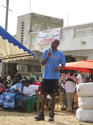 Dikembe Mutombo - Mutombo speaks to the Senegalese population about the importance of sleeping under mosquito nets.