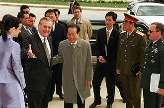 Qian Qichen - Donald Rumsfeld welcomes Vice Premier Qian Qichen as he arrives at the Pentagon on March 22, 2001