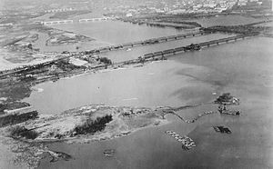 Columbia Island (District of Columbia) - Dreding operations in the Potomac River in 1930. Note the floating pontoons which outline the soon-to-be-completed land which will define the Pentagon Lagoon, and the unfinished central bascule span in Arlington Memorial Bridge.