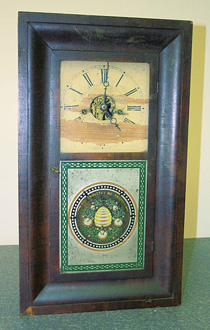 Ogee - Ogee clock, framed with ogee moulding.