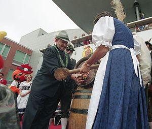 Kitchener-Waterloo Oktoberfest - Elizabeth Witmer MPP taps keg to open Oktoberfest (October 11, 1996)