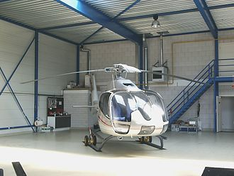 Heli Holland - A Eurocopter EC 130 operated by Heli Holland in a hangar at Lelystad Airport