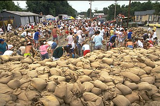 Sandbag - Residents and volunteers work to fill sandbags during the Mississippi and Missouri river floods of 1993.