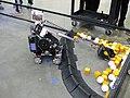 FIRST Championship Detroit 2019 – Bot picking up minerals 3.jpg