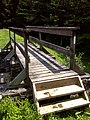 FLT M23 5.42 mi - Bridge over outlet of Lower Pond, 18' long, 2x6x38 deck boards, 2 pairs 2x6 stringers,2x12 sills on stone-concrete, 2 hand rails of 2x6s - panoramio.jpg