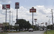 Neighboring fast food restaurant advertisement signs in Bowling Green, Kentucky
