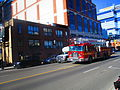 Fire trucks turn West on Front, fromt station 333, 2016 04 15 (6) (25899034753).jpg
