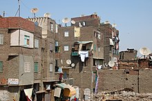 Tenements with satellite dishes and debris