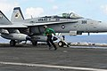 Flickr - Official U.S. Navy Imagery - A Sailor runs out of the catapult area after an inspection of the launch bar..jpg