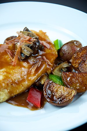 Chicken marsala made with quartered Cremini mu...