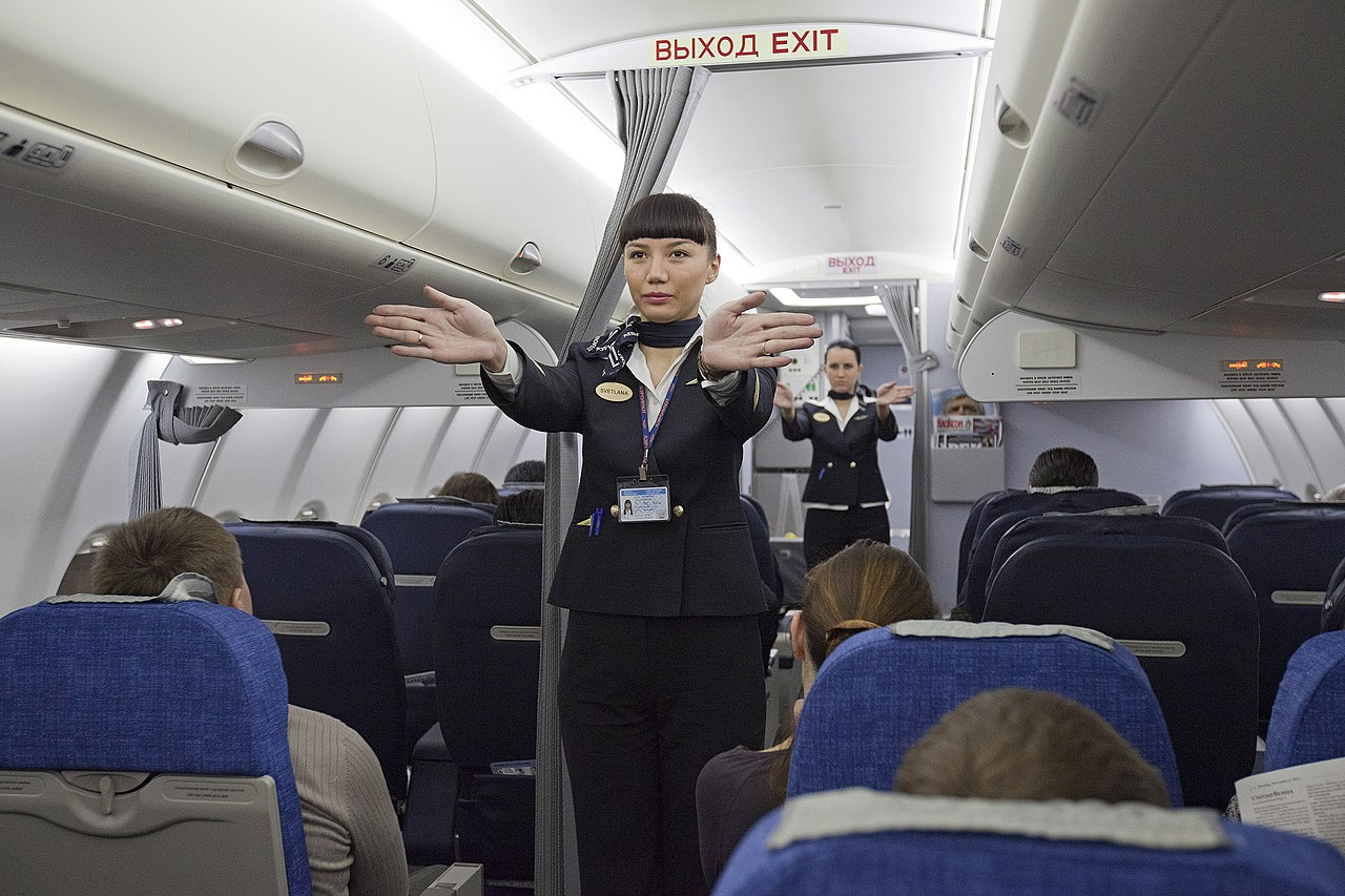 aeroflot attendant File:Flight attendants performing a pre-flight safety demonstration on an Aeroflot Sukhoi Superjet.jpg