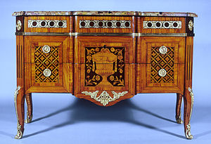Commode - A Neoclassical Parisian marquetry commode of mid-1770s, showing vestiges of the Rococo in the stiffened cabriole legs and softened transitions between planes (Walters Art Museum)