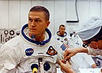 Frank Borman suiting up on launch day.jpg