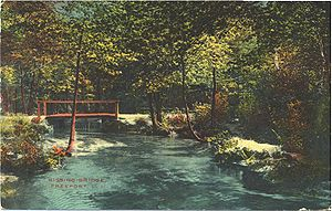 "Freeport, New York - The ""Kissing Bridge,"" which no longer exists, crossed the Freeport-Baldwin border over Milburn Creek at Seaman Avenue. Postcard c. 1913."