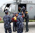 French and Polish Rescue team with Nepalese Army are boarding quake affected injured persons on an IAF Helicopters, in Melanchi, Nepal.jpg