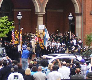 William Donald Schaefer - The flag-draped casket of William Donald Schaefer being carried into historic Old Saint Paul's Episcopal Church, at North Charles and East Saratoga Streets, April 27, 2011