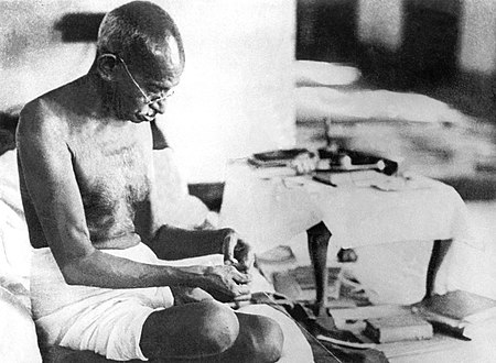 Mahatma Gandhi spinning yarn in 1942. Gandhi believed in a life of simplicity and self-sufficiency. Gandhi spinning 1942.jpg