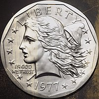 One side of a coin design, depicting the bust of a woman representing Liberty
