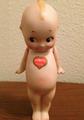 German Kewpie with Heart Sticker.png